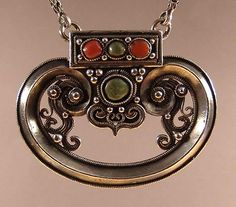 A pendant in the matrix/kidney, millenary shape. Mongolia. Probably XIX century.
