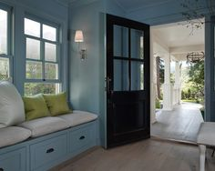 A black and blue front door opens to a blue mudroom filled with a blue built-in bench window seat adorned with bronze cup pulls lined with heather gray cushions and lime green linen pillows. Exterior Tradicional, Black Front Doors, Black Door, Traditional Exterior, Built In Bench, Luxury Interior Design, Cottage Homes, Cottage Style, Farmhouse Style