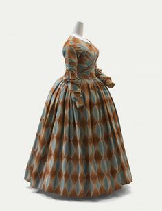 Dress: ca. 1840, English, wool, silk. I love the harlequin challis? fabric and the sleeves which are puffed at the elbow