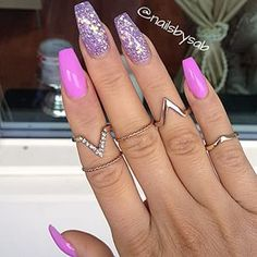 Statement rings to compliment the mani.