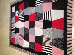 Black,white,and red tumbler quilt.