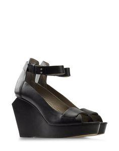 Wedge by Finsk - Love the heel detail.