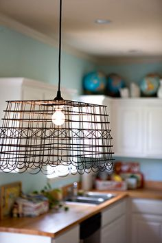 make a cool pendant light, I also spot a globe collection in the background :)