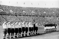 England (white) and Germany (dark) lined up in front of 105,000 spectators at the Olympiastadion on May 14, 1936, both succumbing to the Nazi propaganda machine of the time. England beat Germany 6-3.