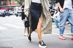 Shop this look for $158:  http://lookastic.com/women/looks/platform-loafers-and-satchel-bag-and-midi-skirt-and-belt-and-trenchcoat-and-crew-neck-t-shirt/3973  — Black and White Leather Platform Loafers  — Black Leather Satchel Bag  — Black Midi Skirt  — Black Leather Belt  — Beige Trenchcoat  — White Crew-neck T-shirt