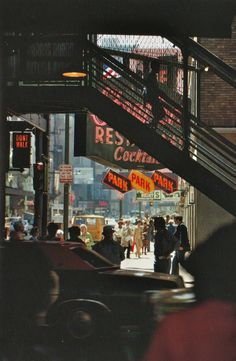 New York (c 1978) | Photographer: Ernst Haas --- I love this shot because of the colours and atmosphere i presents. The fact the foreground is blurred and the background is in focus also makes me feel like i'm there in the scene, standing to cross the road. #streetphotography