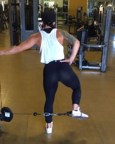 Side Cable Kicks 4x15 each leg (superset w donkey cable kick backs, straight leg cable kick back, dumbbell deadlifts & dumbbell kickback combo) TIPKeep your knee bent the whole time really focus on the muscle contraction. These are definitely one of my go to for building that side #booty ⌛️waist trainer from @squeezmeskinny ⌛️ Use discount code: CANDICE for 10% off!!