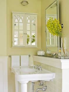 Love this color and the freshness and light. Our mainfloor bathroom is tiny. Abotu 5'x8' including the tub/shower area with no window. This cabinet is a great idea to make it feel like a window. And definitely  a pedestal sink. The vanity cabinet in there now takes up most of the room.