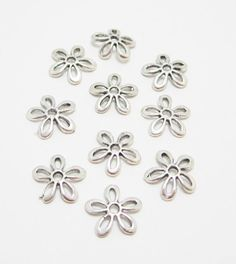 10 Silver Flower Bead Caps 4001 by OverstockBeadSupply on Etsy, $1.60