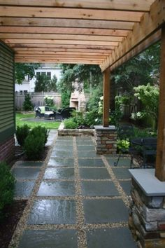 """Love the use of pea gravel with the large slate tiles for """"laying out area"""" on left side of house"""
