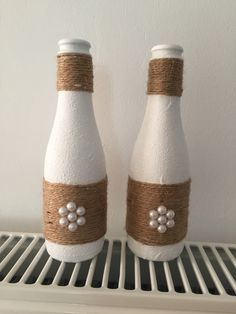 Wine bottle with Cream and Black string and button & pipe cleaner decoration . S… Wine bottle with Cream and … Painted Glass Bottles, Glass Bottle Crafts, Wine Bottle Art, Diy Bottle, Bottles And Jars, Gem Crafts, Diy Crafts For Gifts, Garrafa Diy, Christmas Wine Bottles