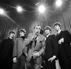 The Beatles are seen with Ed Sullivan in February during a rehearsal for their first American appearance. From left are Ringo Starr, George Harrison, Sullivan, John Lennon and Paul McCartney Ringo Starr, George Harrison, Stuart Sutcliffe, John Lennon, Pop Rock, Rock And Roll, Great Bands, Cool Bands, Paul Mccartney Bass