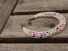 white Viking Knit Bracelet with colorful beads by Shedrem on Etsy, $10.00