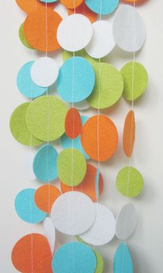 Fun and Bright Felt Circle Garland in White, Orange, Aqua and Lime -  APPROX 10ft / Party Decoration / Photo Prop / Felt Garland. $18.00, via Etsy.