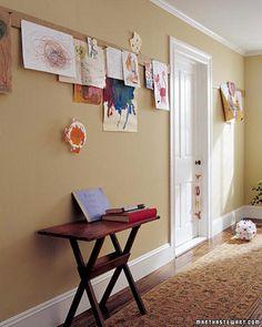 Playroom idea. Strips of cork board to hang art.