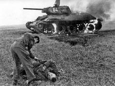Against the backdrop of a burning Soviet tank T-34/76 model 1942,