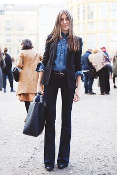 A 70's vibe is created with a pair of flared jeans, a tucked in denim blouse and structured blazer. // #Denim
