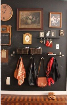 "Wall shelf, hooks, baskets and cup hooks make for a great ""entry"" by front door."