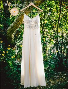 A stunning touch of class. Simple yet elegant, this A-line dress is exquisitely hand beaded with the finest Swarovski crystals and high-quality sequins. The highlight of this magnificent gown is the h