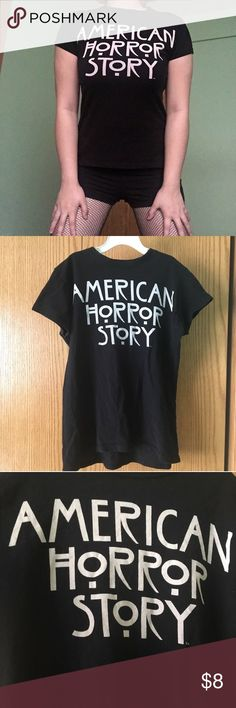 American Horror Story Tee This is my first and only American Horror Story shirt I have and now it doesn't fit me anymore since it shrunk in the wash :( Says it's a size Small can also fit XSmall This shirt is perfect for a fan! I got this shirt at Comic Con :) You can wear this with a plaid flannel over it or tie it around your waist and wear a skirt with fishnet tights :) Hot Topic Tops Tees - Short Sleeve