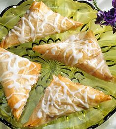 A lightly sweet and spicy mix of apples, raisins, and cinnamon fills these low-fat turnovers made with phyllo dough. Serve them for dessert, breakfast, or brunch.
