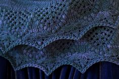 After knitting Annis I was really quite pleased with the crescent shape, and thought it'd be nice to take that and add a border rather than doing a straight scarf or a triangular shawl. So, I...