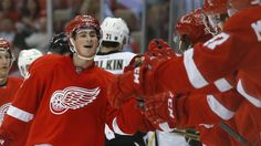 Detroit Red Wings center Dylan Larkin celebrates his goal against the Pittsburgh Penguins in the first period of a preseason NHL hockey game in Detroit Thursday, Sept. 24, 2015. (AP Photo/Paul Sancya)