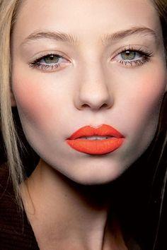 Dramatic lip and bright eyes.