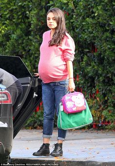 Almost time! Mila Kunis was more than happy to show off her burgeoning baby bump in Studio City on Monday