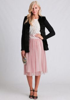 Fall in love with this lovely pink midi skirt adorned with an airy tulle overlay and a Swiss dot design. Complete with a partially elasticized waistband with pintuck details, this cotton-blend sk...