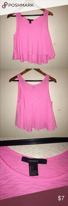 Forever 21 Pink Polyester Racer- Back  , Flows 💟L Very cue, great condition. Pink Racer-Back by Forever 21 , 100% Poly , high low ,( low in back. ) bright pink , very easy to spot with on ., thanks L Forever 21 Tops Tank Tops