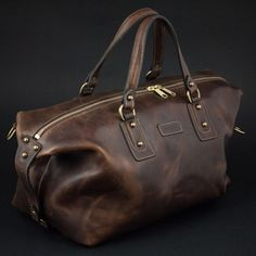 Our Men's Leather Duffel Bag is made by Coronado Leather. Made in the USA with Horween Chromexcel Leather, our Boston Bag is great for a lifetime of Travel.