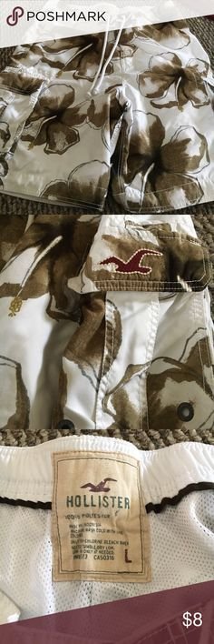 Men's Hollister swim trunks Men's Hollister swim trunks white with brown flowers they're in great condition they're really nice Hollister Swim Swim Trunks