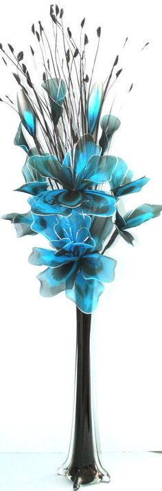 ARTIFICIAL FLOWERS - TEAL NYLON FLOWER ARRANGEMENT IN VASE.