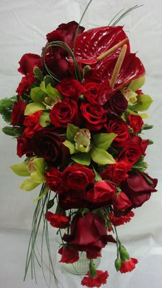 Red and Green Cascading Bouquet  JW Weddings and Events  Charleston, SC