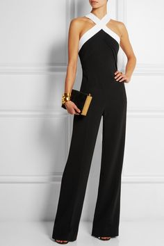 Roland Mouret | Shotwick two-tone stretch-crepe jumpsuit | EDITORS' NOTES & DETAILS Roland Mouret demonstrates just how flattering jumpsuits can be with this 'Shotwick' style from the Resort '15 collection. It's cut from black stretch-crepe that skims your curves and flexes as you move. The contrasting white halterneck and cutout back make an adhesive bra a must.