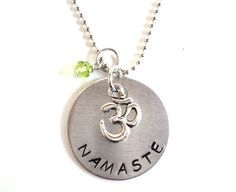 Namaste Hand Stamped Necklace Om Ohm Aum Meditation Yoga Jewelry Engraved Unique Gift For Her Christmas Stocking Stuffer Under 50 Item N5 by BohemianEarthDesigns on Etsy https://www.etsy.com/listing/168068199/namaste-hand-stamped-necklace-om-ohm-aum