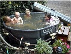 *Hot tub made from 300 gallon Rubbermaid stock tank. This picture really gives a good idea of how roomy these 300 gallon stock tanks are inside. This stock tank can be ordered online at Ace Hardware, and other places. I'd just use mine as a swimming pool.