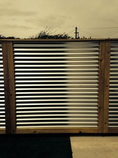 Corrugated metal fence panels