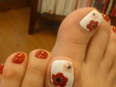 White big toe with flowers and red remaining toes ---repinned by acb