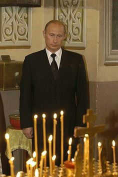President Vladimir Putin In Silent Contemplation During A Visit To Church