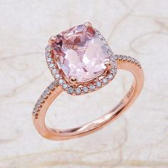 Morganite Halo Engagement Ring in Rose Gold. #morganite #morganiterings #morganitering #morganiteengagementrings #engagementrings #engagementring #yesido #weddings #weddingideas #proposalideas #rosegoldrings #rosegoldengagementrings
