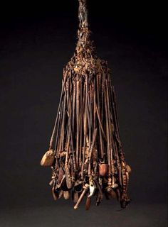 Africa | Divination object from the Bambara or Dogon people of Mali | Multitude of sticks held together with leather, with various objects such as bones, cowrie shells, seeds, hair, fur and other objects hanging from the ends
