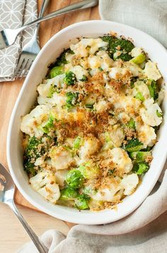 This luscious Winter Veggie Gratin isn't your average casserole! Tender broccoli, cauliflower, and brussels sprouts are blanketed with a creamy béchamel sauce with vanilla-infused caramelized onions, Gouda, and Gruyere cheeses, then topped with golden breadcrumbs for a side dish that's destined to impress!