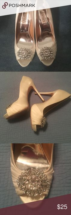 Badgley Mischka Wedding Heels! The perfect weeding shoes!! Worn once for a wedding. Good used condition with some signs of wear but would still be perfect for a wedding and will photograph beautifully! Sz. 8 Color: Off White Material: satin Badgley Mischka Shoes Heels