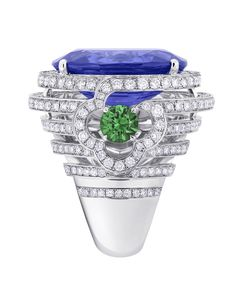 Side view of the Orangerie des Tuileries ring from the Escale á Paris collection of jewels by Louis Vuitton featuring Tanzanites, green tsavorites and diamonds.