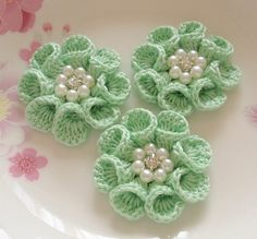 These crochet flowers made with sheeny cotton yarn. these flowers with pearl and… These crochet flowers made with sheeny cotton yarn. these flowers with pearl and rhinestone on the … Bouquet Crochet, Crochet Flower Hat, Crochet Flower Tutorial, Crochet Leaves, Crochet Motifs, Crochet Flower Patterns, Crochet Jewelry Patterns, Crocheted Lace, Pattern Flower