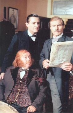 Picture of Sherlock, Watson, and a client from The Red-Headed League.