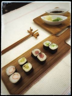Sunday night brings happy sight of Sushi and it tastes even better when served in your individual teak tray. #organiqliving #homeessentials #sushi #sushinight #sundaynight #closetonature #teakwood #chabatree #happy #chopsticks #natural #forest #wood trays, chopsticks and stand available on www.organiqliving.com #mydubai