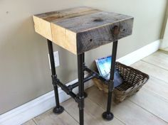 Weathered barnwood side table, end table or nightstand/bedside table. Modern industrial style featuring steel pipe legs.